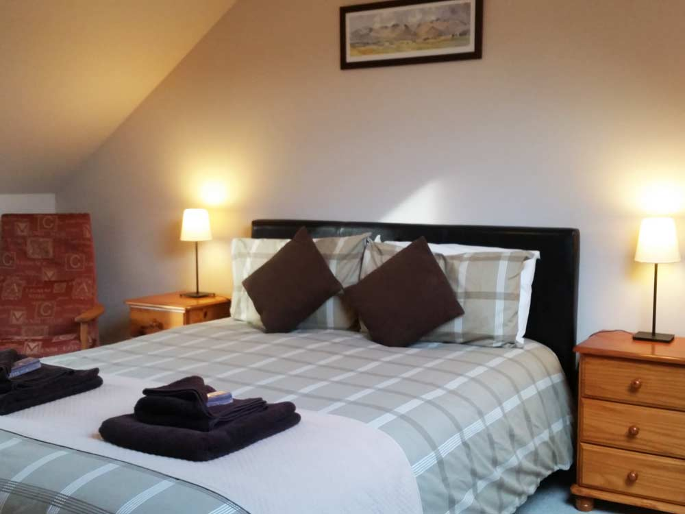 master-bedroom-with-views-of -the-Cairngorm-Mountain-and-ski-area